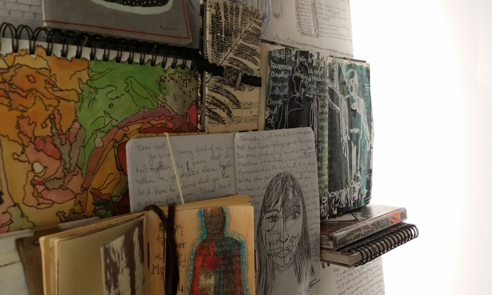 Up close view of the journals on display at the Riverside Art Museum
